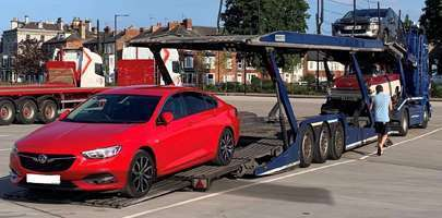Image of client's car going onto a car transporter in readiness to take with him on his overseas posting.